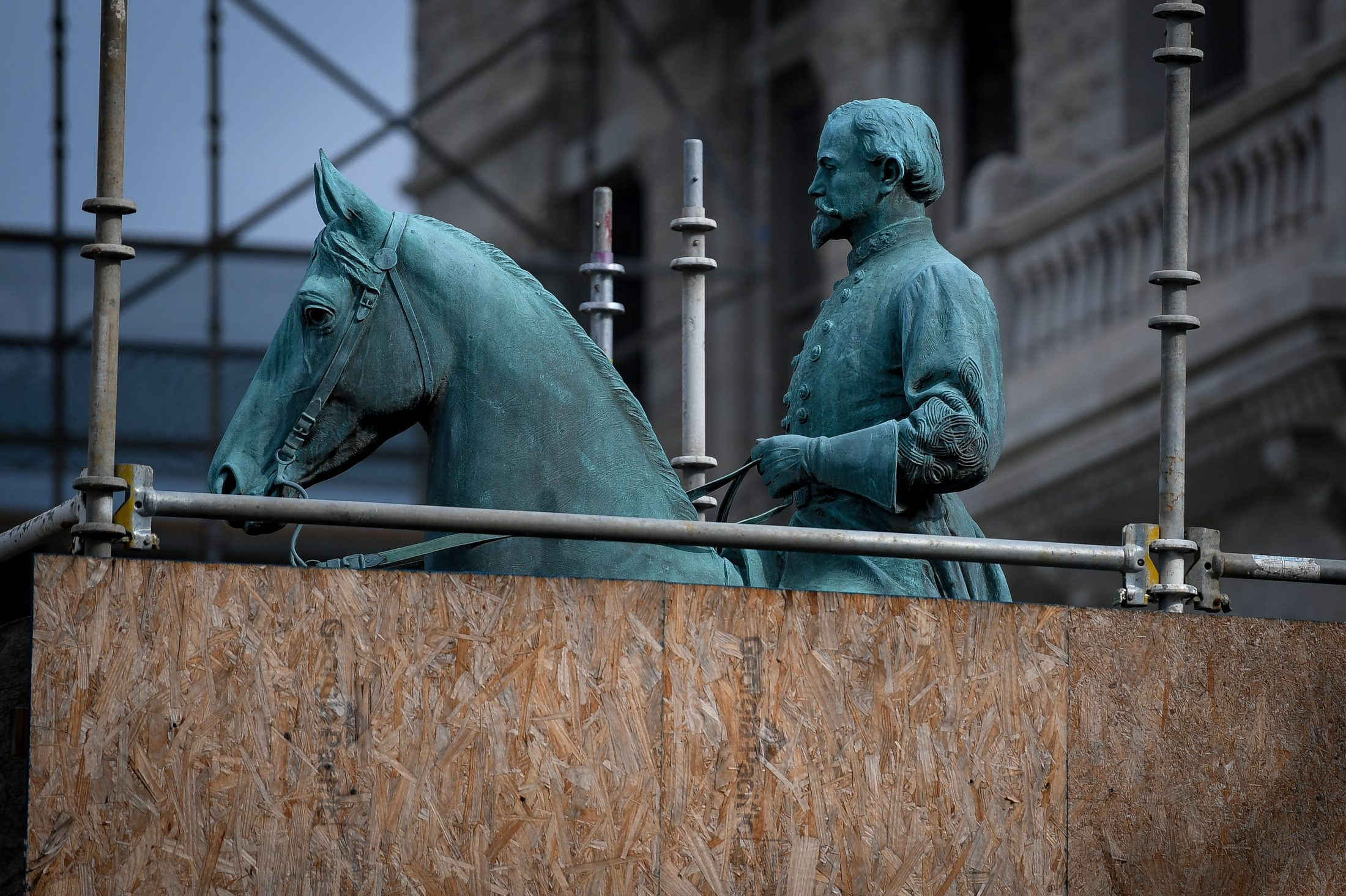 A monument to Confederate General John Hunt Morgan stands encased in a protective scaffolding because of local construction, outside the Historic Lexington Courthouse in Lexington, Kentucky. Photo by Bryan Woolston/Reuters