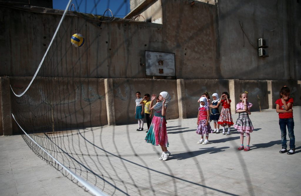 Students play volleyball at a school in Douma. A ceasefire was declared in southwestern Syria in July. Photo by Bassam Khabieh/Reuters
