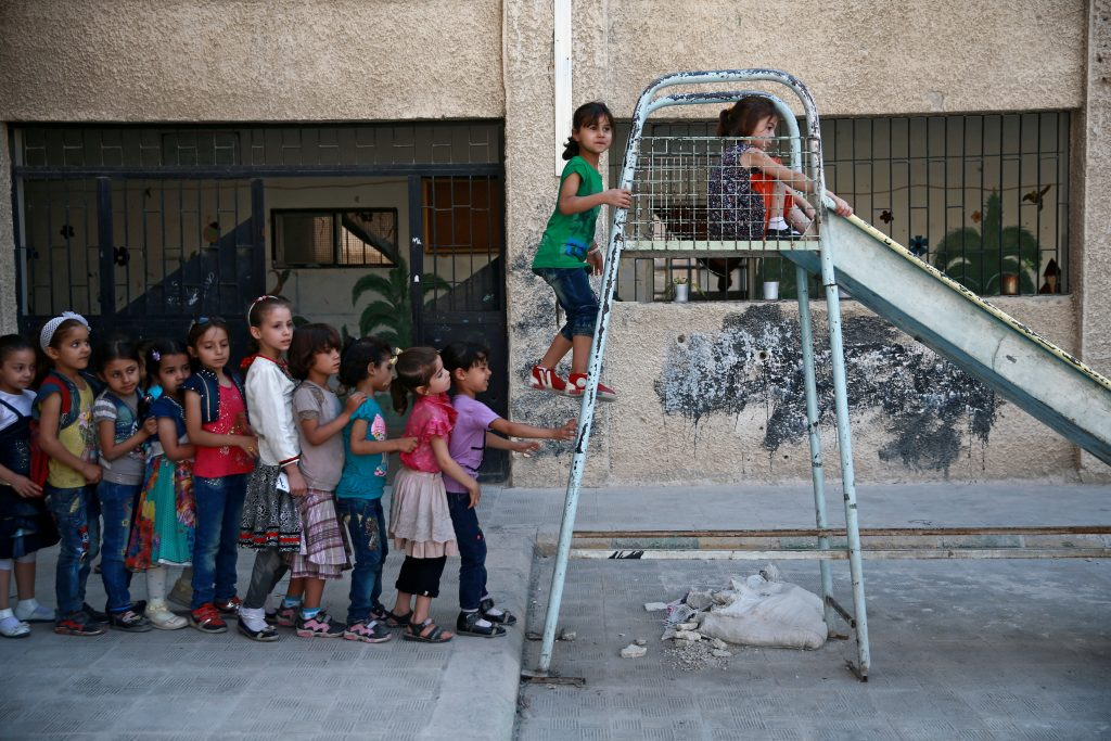 Students play at a school in Douma, near Damascus, Syria on Aug. 16. Photo by Bassam Khabieh/Reuters