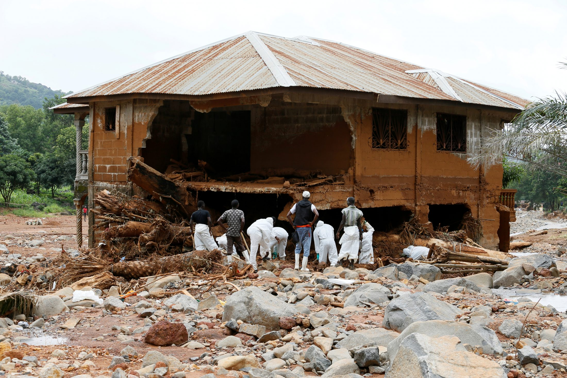 Rescue workers are seen last week searching through rubbles around a house for bodies at Pentagon, in Freetown, Sierra Leone. Photo by Afolabi Sotunde/Reuters