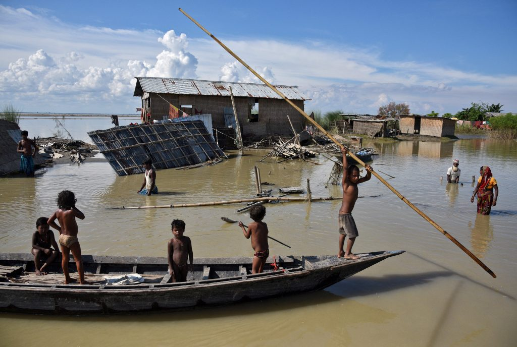 Children row a boat in the Morigaon district in the northeastern state of Assam, India on Aug. 20. Photo by Anuwar Hazarika/Reuters