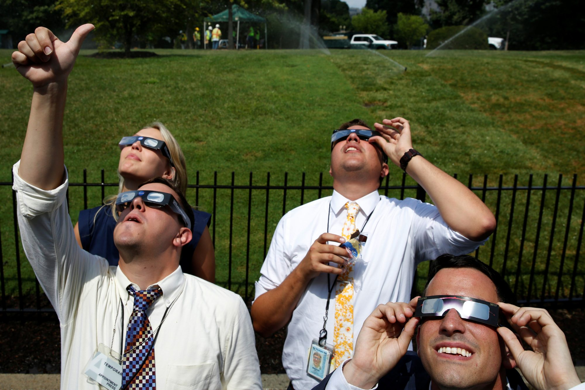 Members of the media watch the solar eclipse at the White House in Washington D.C.. Photo by Yuri Gripas/Reuters