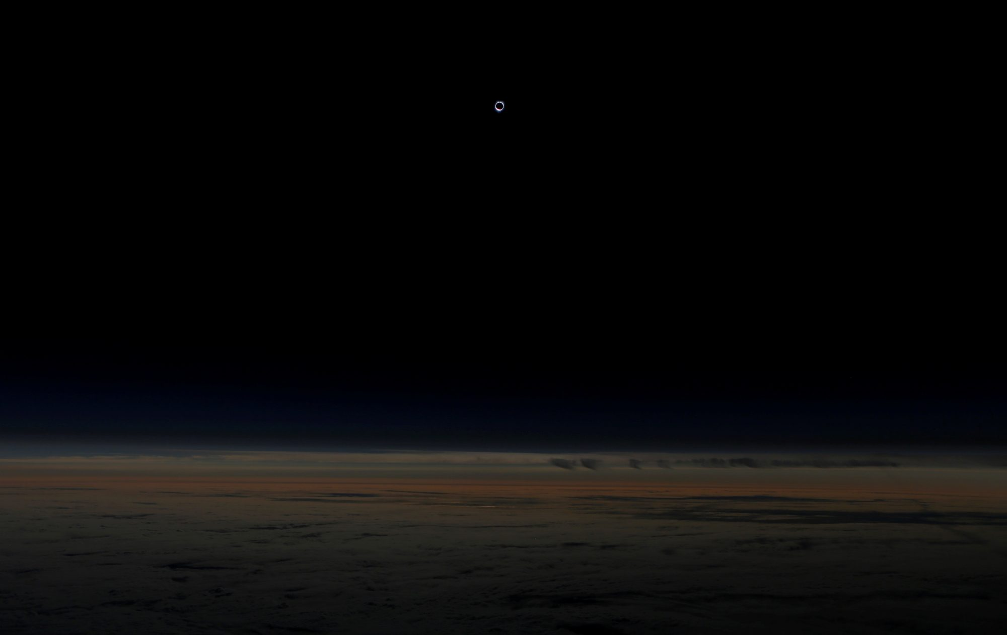 The sun is obscured by the moon during the solar eclipse as seen from an Alaska Airlines commercial jet at 40,000 feet above the Pacific Ocean off the coast of Depoe Bay, Oregon. Photo by Jim Urquhart/Reuters