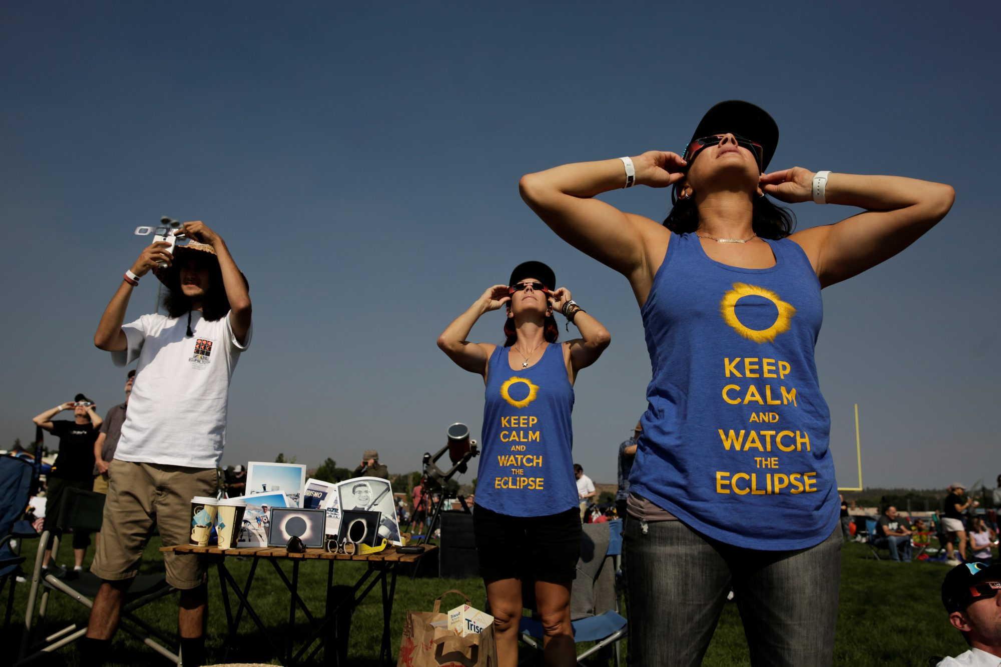 People watch the solar eclipse during the Lowell Observatory Solar Eclipse Experience at Madras High School in Madras, Oregon. Photo by Jason Redmond/Reuters