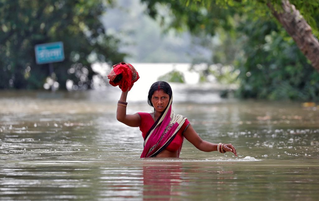 The worst monsoon-related flooding in years has killed more than 1,200 in South Asia, news outlets report. Photo by Cathal McNaughton/Reuters