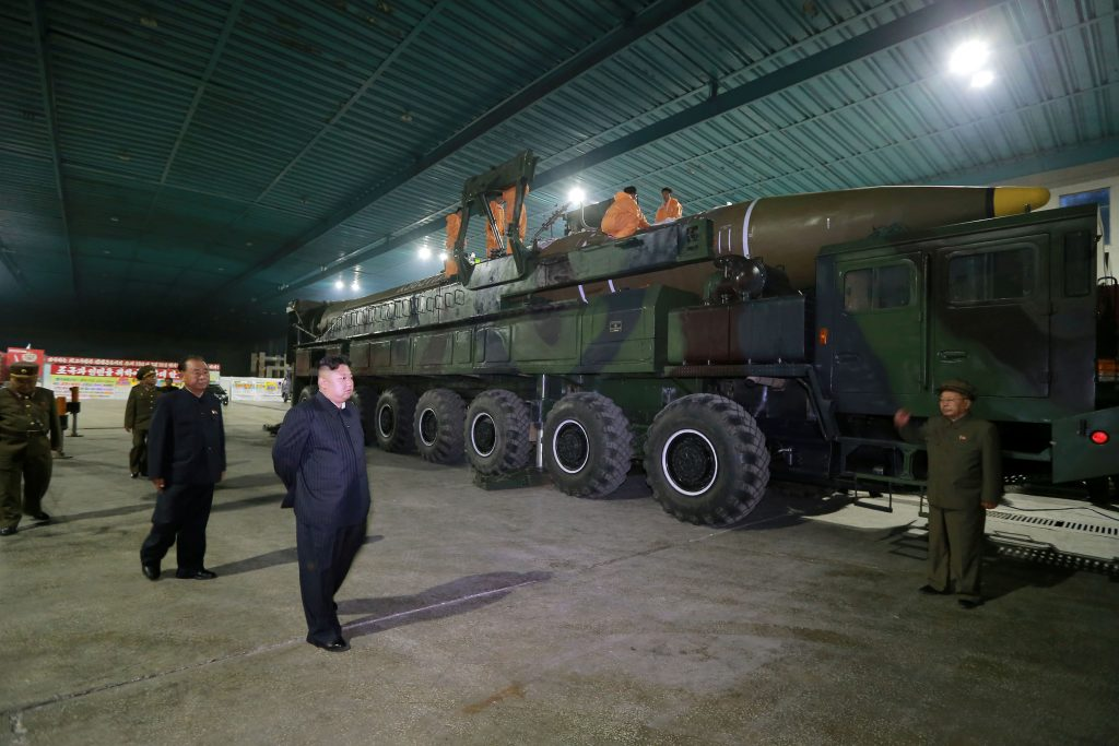 North Korean leader Kim Jong Un inspects the intercontinental ballistic missile Hwasong-14 in this undated photo released by KCNA