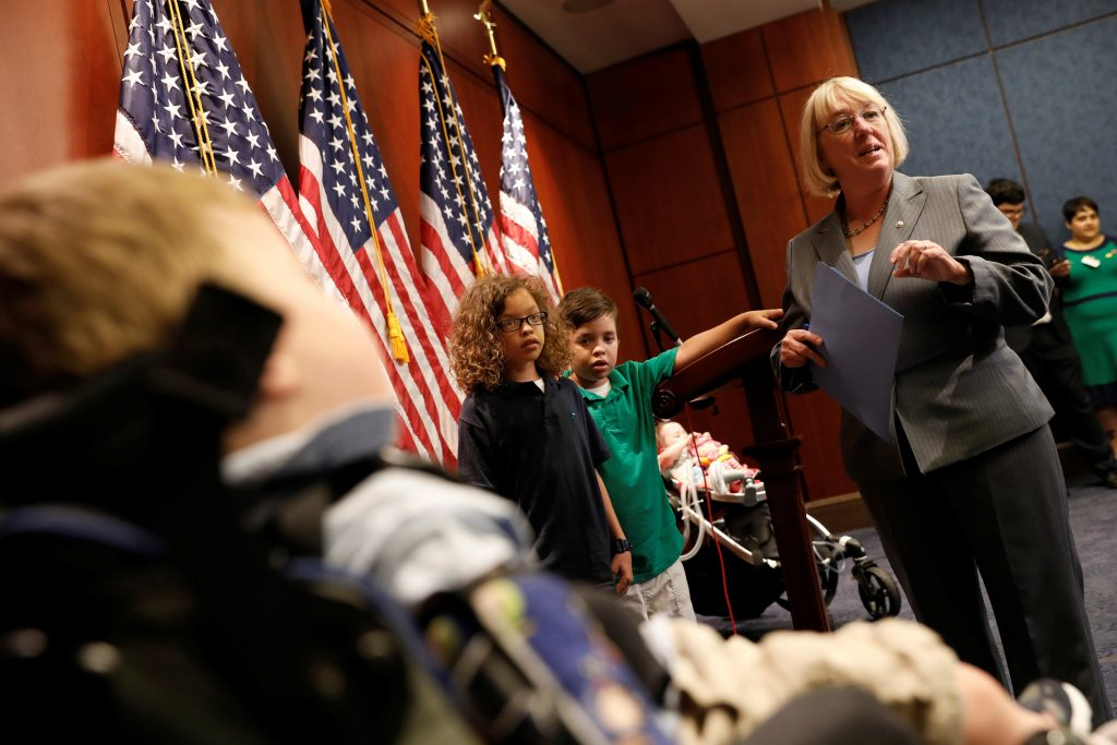 Sen. Patty Murray (D-WA), accompanied by children with preexisting conditions covered under the Affordable Care Act, arrives for a press conference about the Senate health care bill on Capitol Hill in Washington, U.S., July 12, 2017. REUTERS/Aaron P. Bernstein - RTX3B7FU