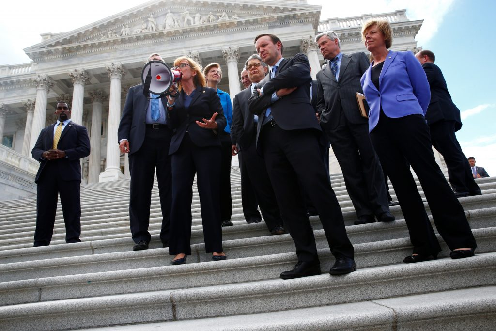Senate Democrats gather on the Senate steps with health care protesters on Capitol Hill in Washington, D.C. Photo by Eric Thayer/Reuters