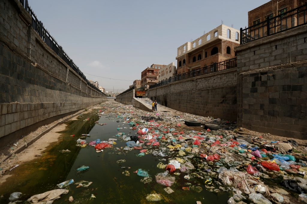 In Yemen, health workers advise communities to clean up the trash in streets and sewage channels. Photo by Khaled Abdullah/Reuters