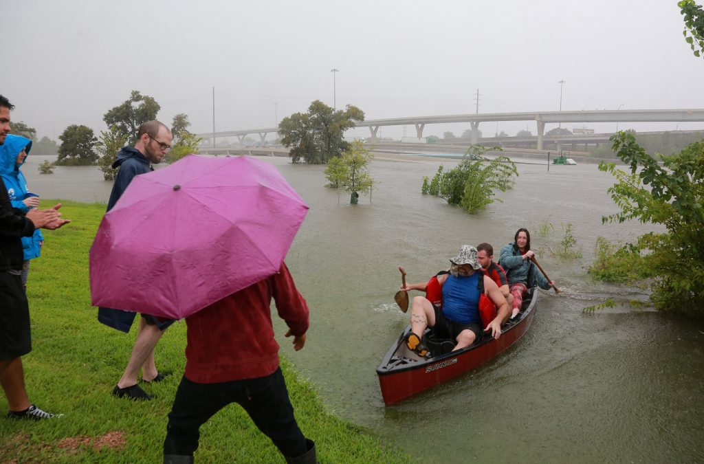 Area residents use a kayak to rescue motorists stranded on Interstate highway 45 which is submerged from the effects of Hurricane Harvey in Houston, Texas, on Aug. 27. Photo by Richard Carson/Reuters