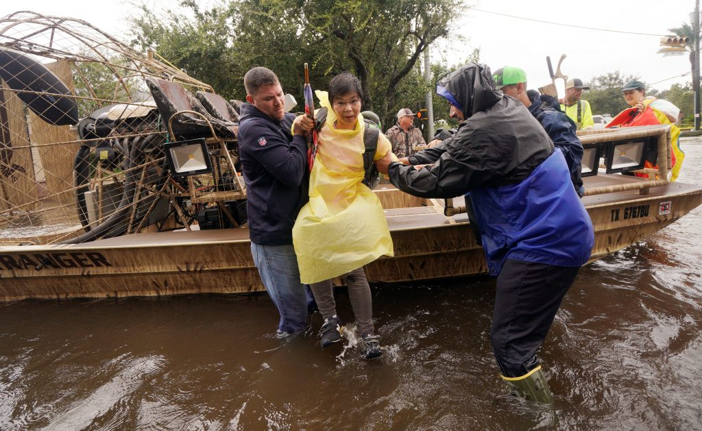 A woman is evacuated by airboat from the Hurricane Harvey floodwaters in Houston on Aug. 29. Photo by Rick Wilking/Reuters