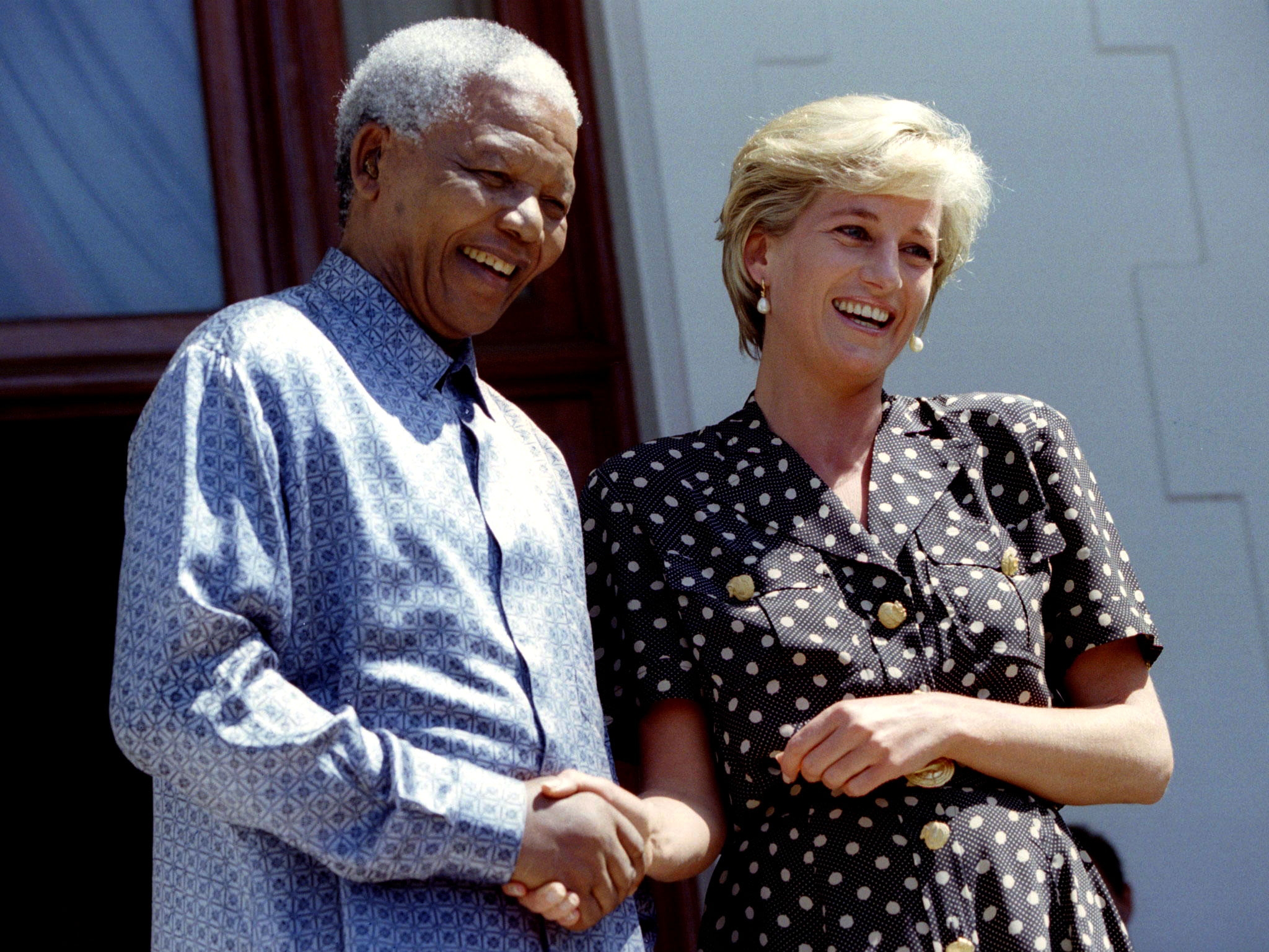 Princess Diana meets South African President Nelson Mandela in Cape Town on March 17, 1997. He praised her for having influenced his government to ban the making of anti-personnel mines. Photo by Juda Ngwenya/Reuters