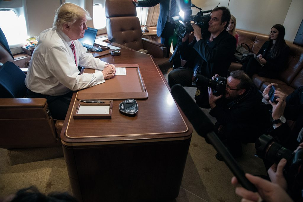 President Donald Trump talks to members of the press in his office aboard Air Force One during a flight from Philadelphia, Pennsylvania, to Joint Base Andrews in Maryland, January 26, 2017. (Official White House Photo by Shealah Craighead)