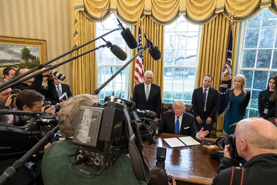 President Donald J. Trump signs a series of Executive Orders and Presidential Memoranda around the approval of pipelines in the Oval Office, Tuesday, Jan. 24, 2017. (Official White House Photo by Shealah Craighead)