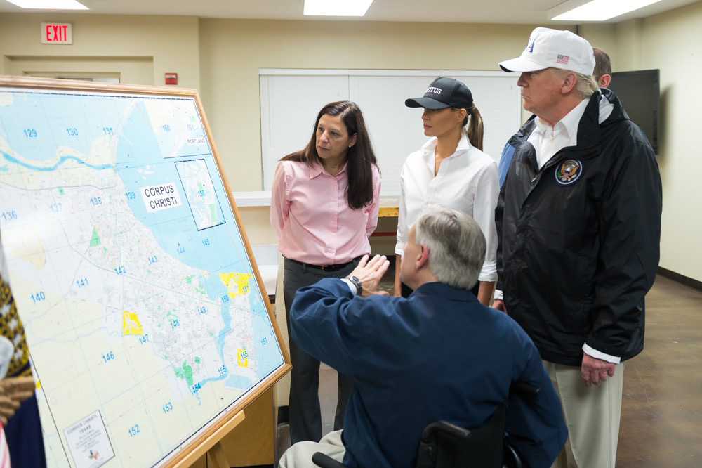 President Donald Trump and first lady Melania Trump, joined by Acting Homeland Security Secretary Elaine Duke (left), get a briefing from Texas Gov. Greg Abbott on Hurricane Harvey relief and rescue efforts in Corpus Christi, Texas, on Aug. 29. Photo by Andrea Hanks/White House