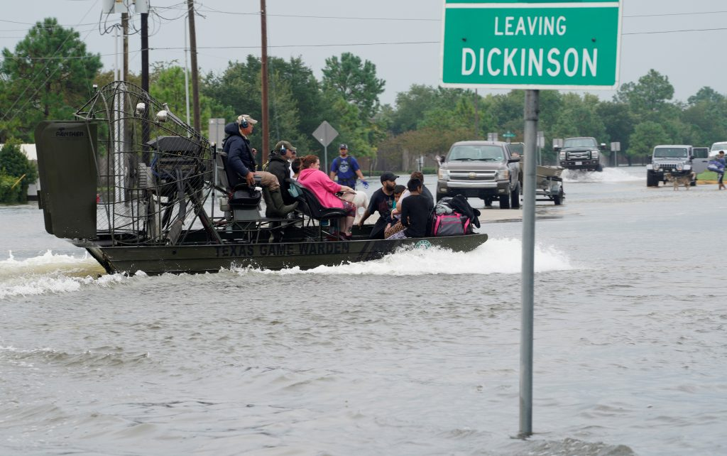 People are rescued by airboat as they evacuate from flood waters from Hurricane Harvey in Dickinson, Texas August 27, 2017. Photo by Rick Wilking/REUTERS
