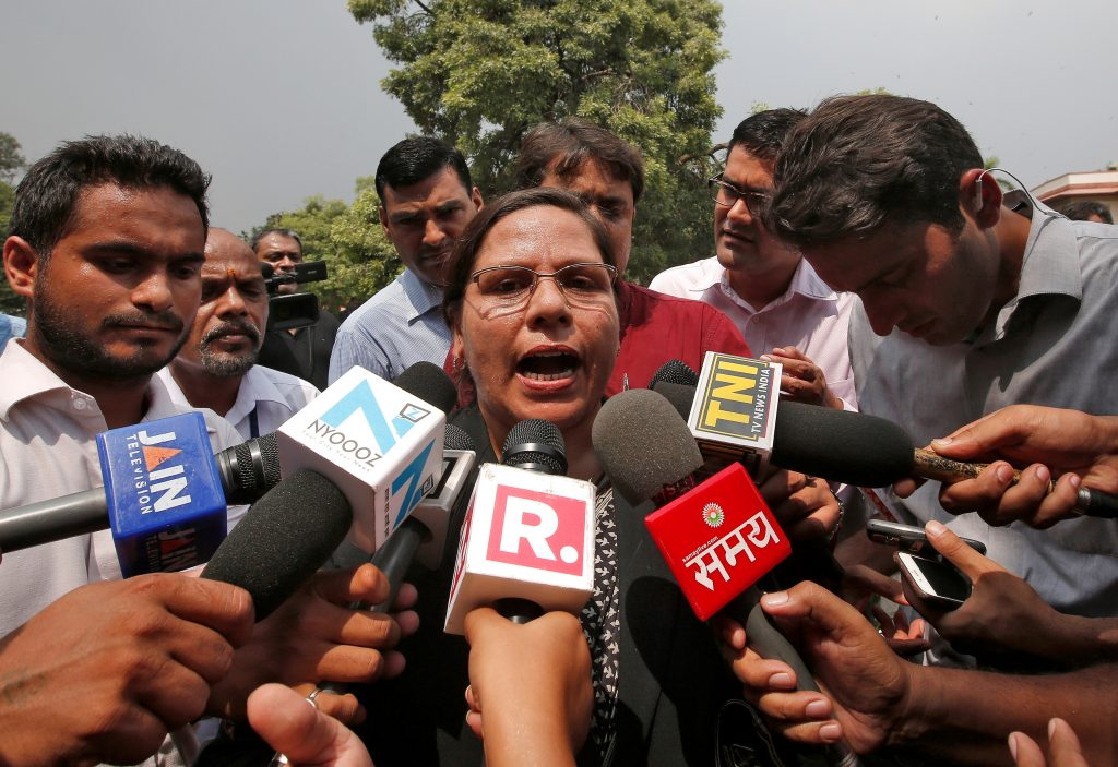Farha Faiz, a lawyer, speaks with the media after a verdict for the controversial Muslim quick divorce law outside the Supreme Court in New Delhi, India August 22, 2017. REUTERS/Adnan Abidi - RTS1CROX