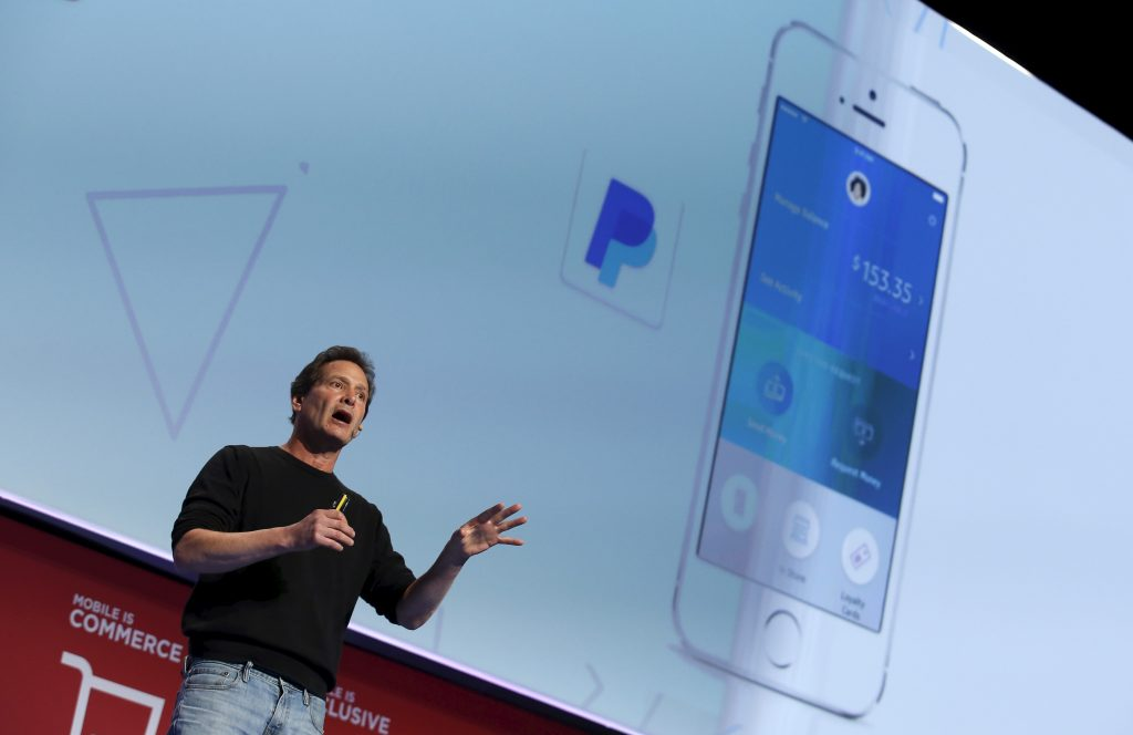 Dan Schulman, CEO of PayPal, delivers a keynote speech during the Mobile World Congress in Barcelona, Spain February 22, 2016. REUTERS/Albert Gea - RTX281GE