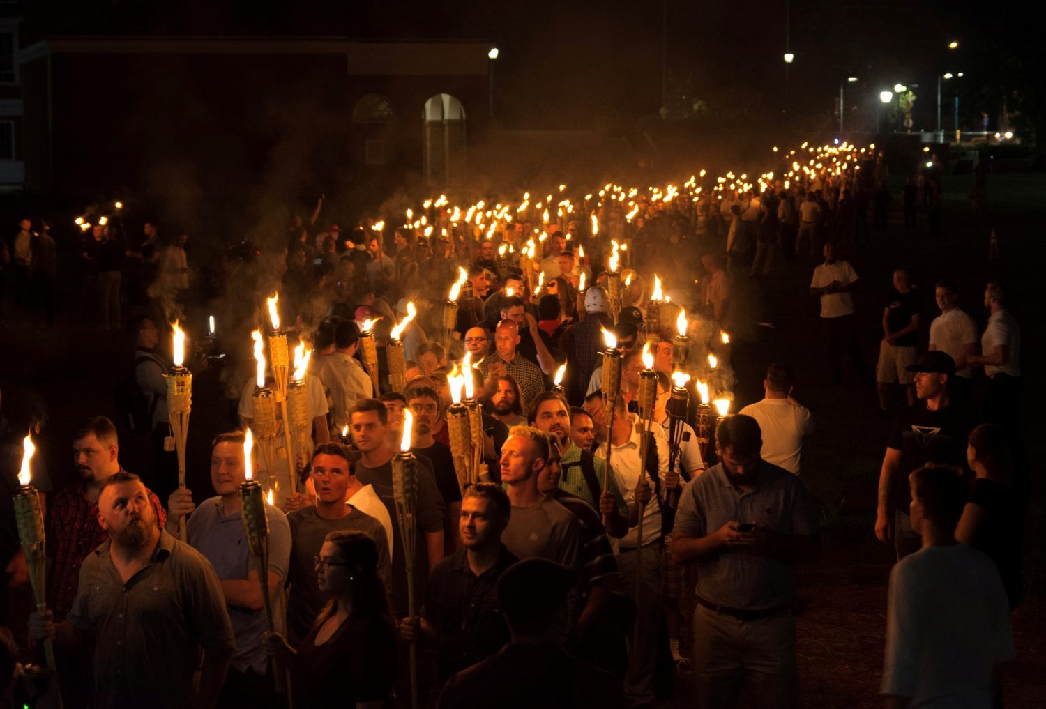 White nationalists carry torches on the grounds of the University of Virginia, on the eve of a planned Unite The Right rally in Charlottesville, Virginia, U.S. August 11, 2017. Picture taken August 11, 2017. Photo by Alejandro Alvarez/News2Share via REUTERS
