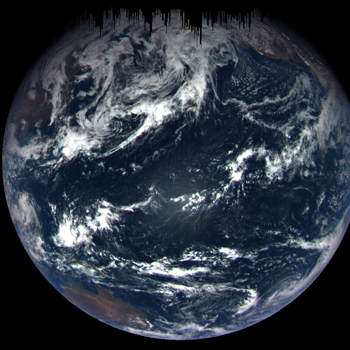 An image of Earth taken by the OSIRIS-REx MapCam on Sept. 22. The view shows the Pacific Ocean, with Australia in the lower left and Baja California and the southwestern U.S. in the upper right. The dark streaks at the top are due to short photo exposure times, which are need to capture an object as bright as Earth. Photo by NASA's Goddard Space Flight Center/University of Arizona