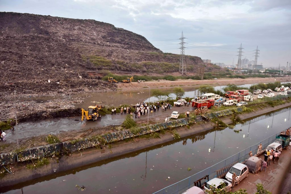 The Ghazipur landfill in Delhi was supposed to stop accepting garbage at about 65 feet, but it had reached a height of about 165 feet when part of it slid into a nearby canal. Photo by Mohd Zakir/Hindustan Times via Getty Images