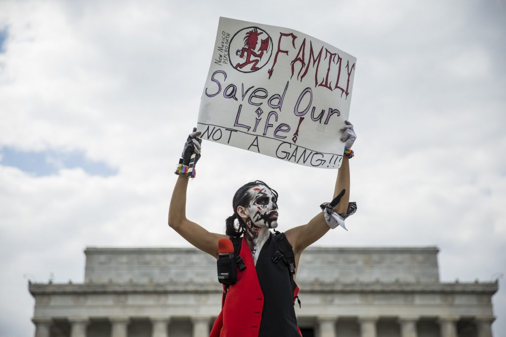 A Juggalo holds up a sign in front of the Lincoln Memorial during the Juggalo March in Washington, USA on September 16, 2017. (Photo by Samuel Corum/Anadolu Agency/Getty Images)