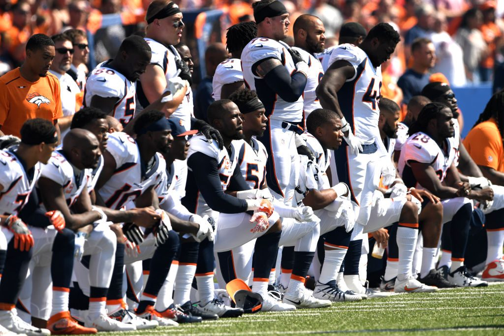 Kneeling during the national anthem before the Denver Broncos play the Buffalo Bills at the New Era Stadium, Orchard Park, NY. Photo by Joe Amon/The Denver Post via Getty Images