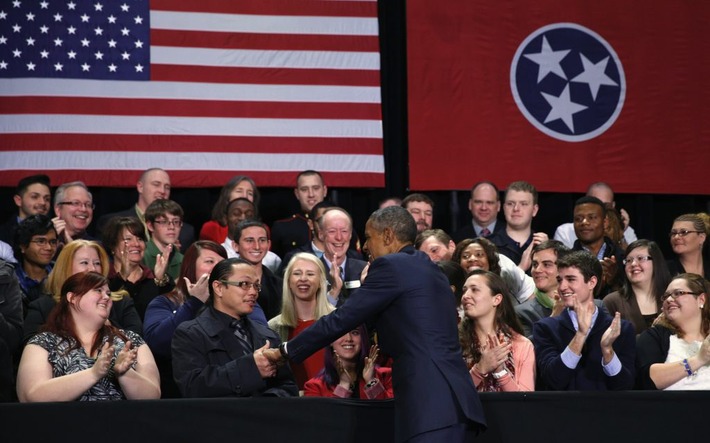 In 2015, then-President Barack Obama shakes hands as he arrives to speak about during a visit to Pellissippi State College in Knoxville, Tennessee. Obama made the case that two years of community college should be free and universally available, a proposal he said on Thursday he would flesh out in his State of the Union speech later this month. REUTERS/Kevin Lamarque