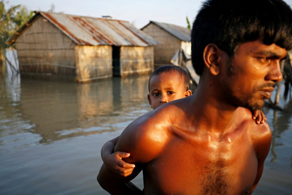 Oxfam reported that two-thirds of Bangladesh was under water. Photo by Mohammad Ponir Hossain/Reuters