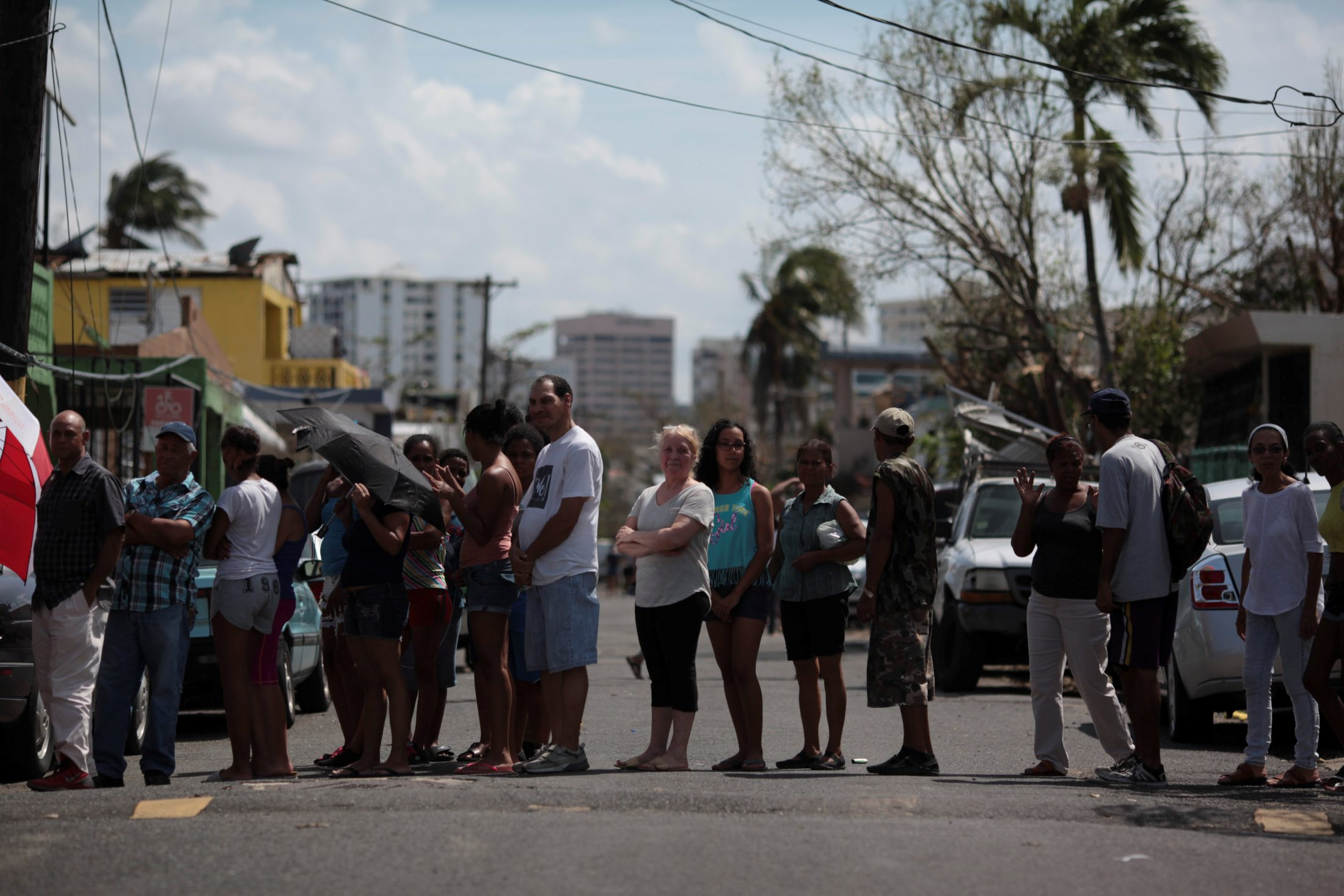 People wait in line for relief items to be distributed, after the area was hit by Hurricane Maria in San Juan, Puerto Rico. Photo by Alvin Baez/Reuters
