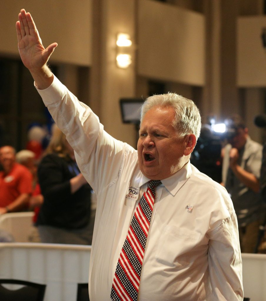 Local Alabama politician Jimmy Ziegler reacts after Republican candidate Roy Moore has been announced the winner over incumbent Luther Strange to his supporters at the RSA Activity center in Montgomery, Alabama, U.S. September 26, 2017, during the runoff election for the Republican nomination for Alabama's U.S. Senate seat vacated by Attorney General Jeff Sessions.  REUTERS/Marvin Gentry