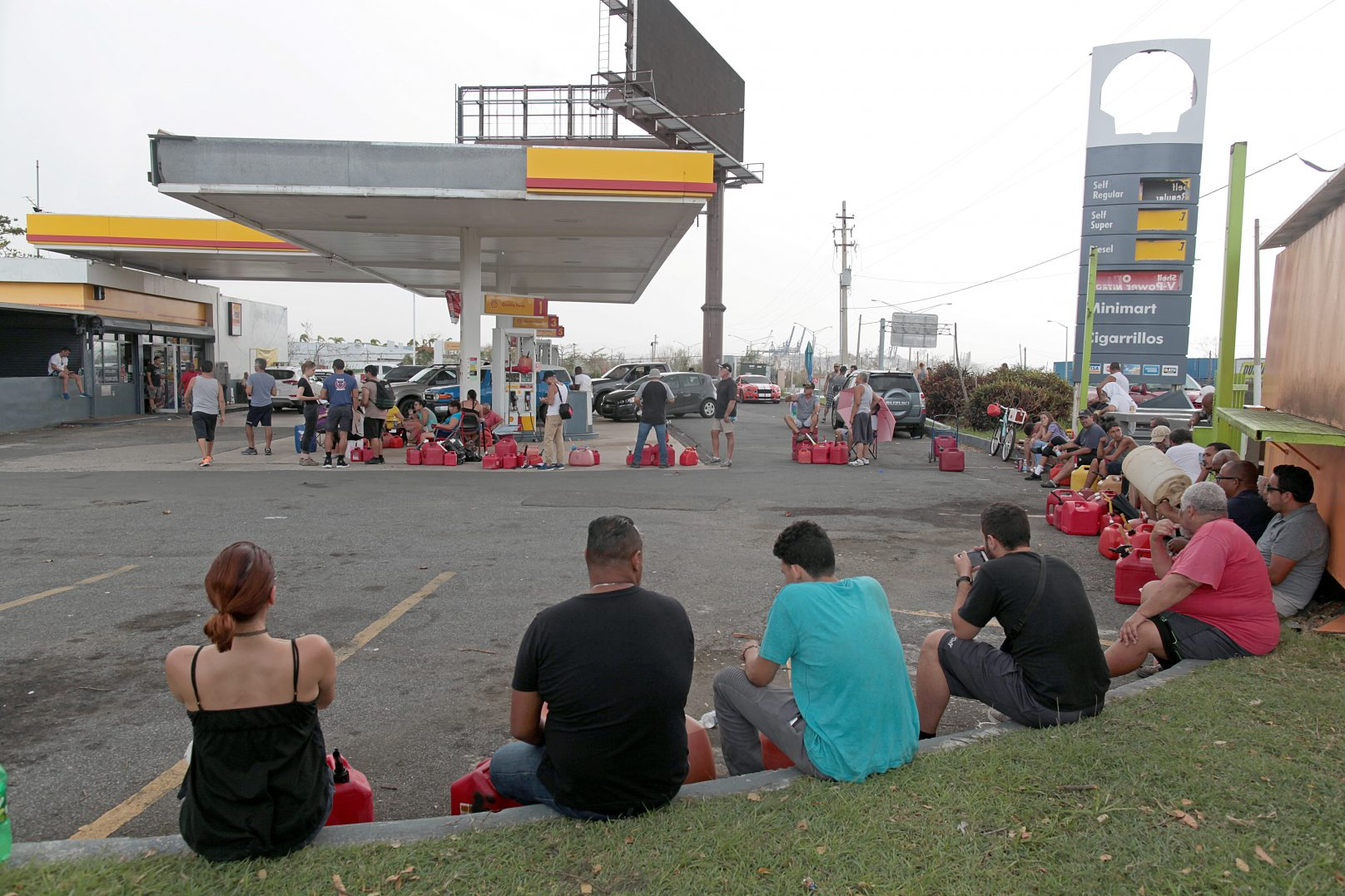 People wait at a gas station to fill up their fuel containers, in the aftermath of Hurricane Maria, in San Juan