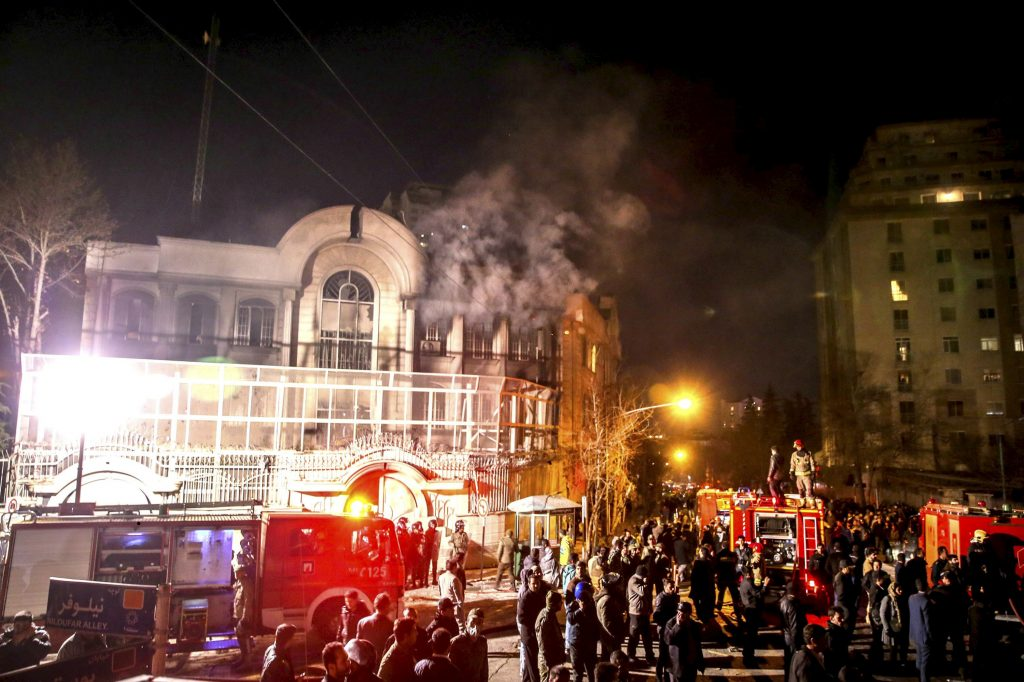 Flames rise from Saudi Arabia's embassy after it was stormed by Iranian protesters during a demonstration in Tehran