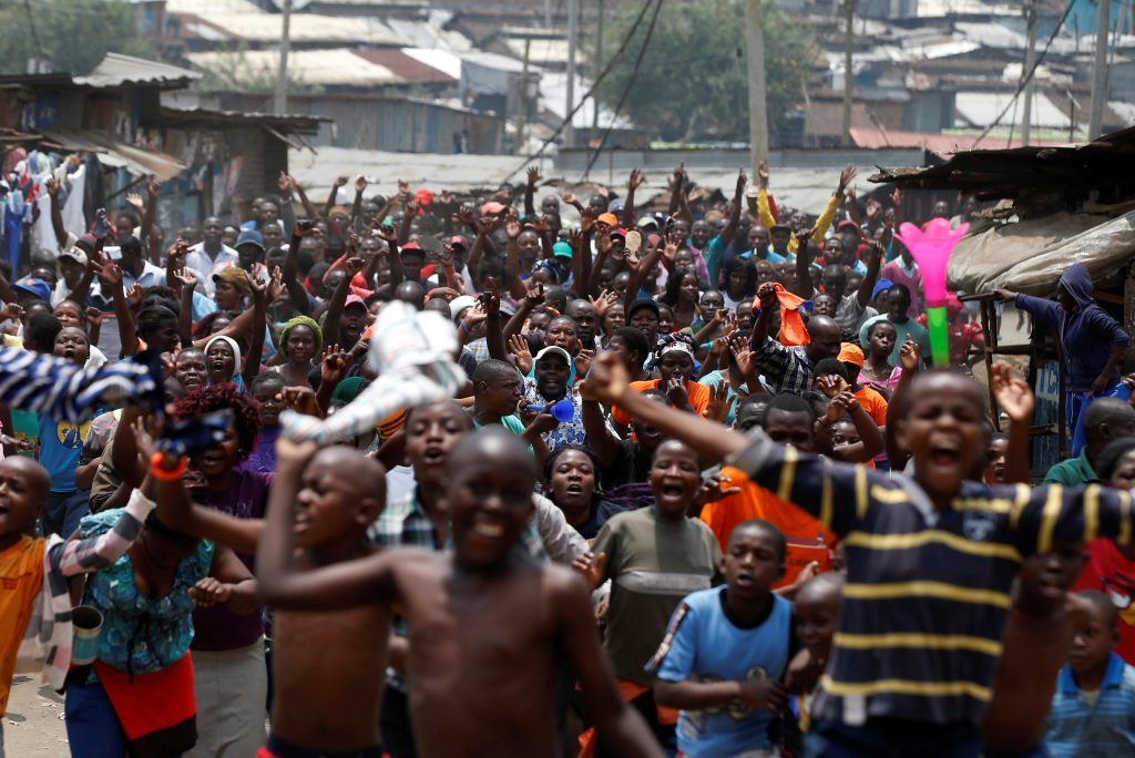 Supporters of an opposition leader Raila Odinga celebrate in Mathare slum after President Uhuru Kenyatta's election win was declared invalid by a court in Nairobi, Kenya, Sept. 1. Photo by Siegfried Modola/Reuters
