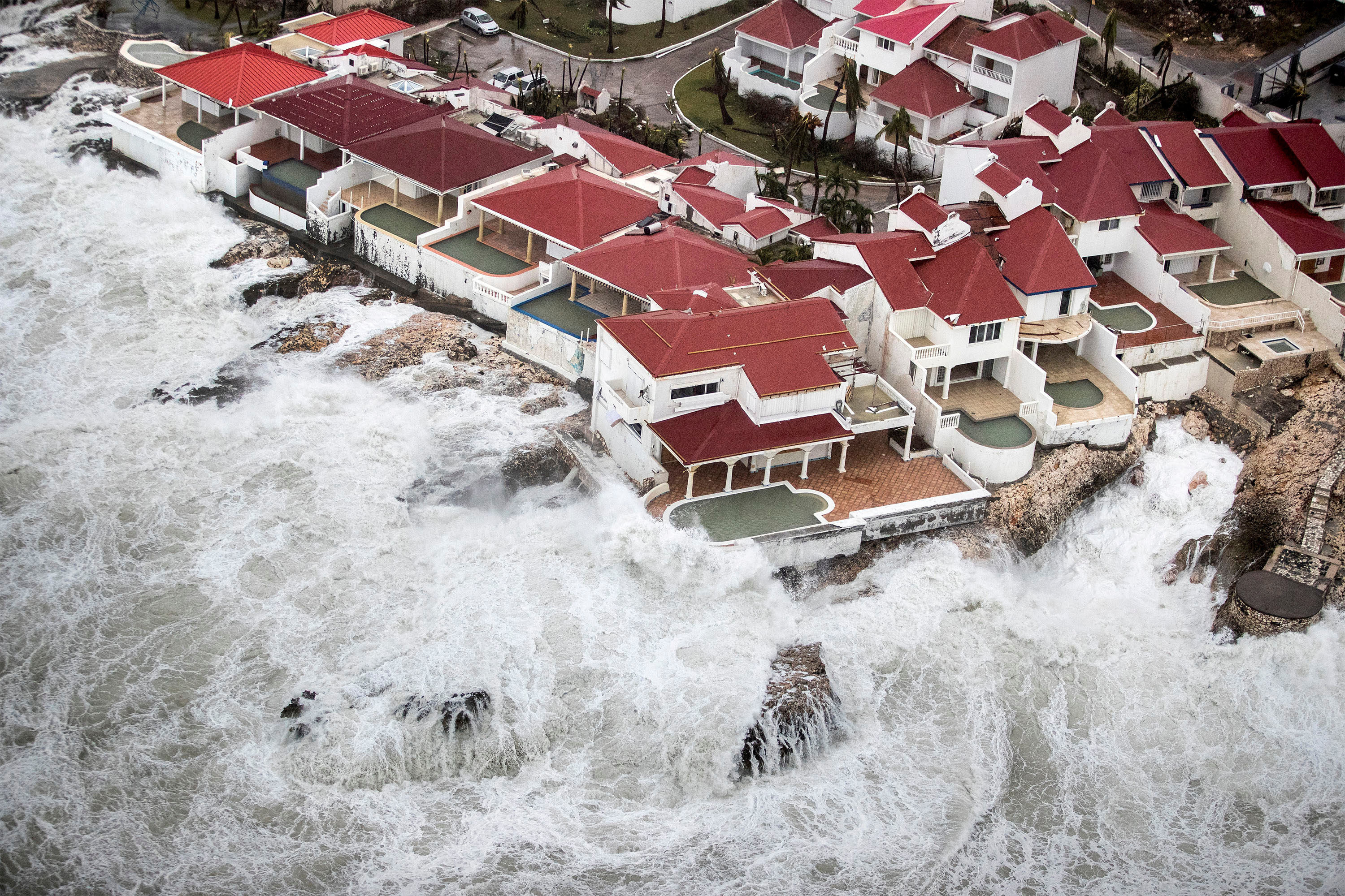 Waves crash around buildings on Saint Martin island. Photo by Netherlands Ministry of Defense/Handout via Reuters