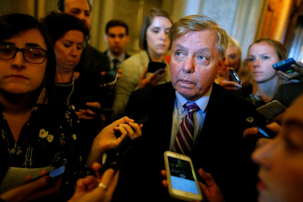 U.S. Senator Lindsey Graham (R-SC) speaks to reporters about proposed legislation to repeal Obamacare, after the weekly Republican caucus policy luncheon at the U.S. Capitol in Washington, U.S. September 19, 2017. REUTERS/Jonathan Ernst - RC187E9A07F0