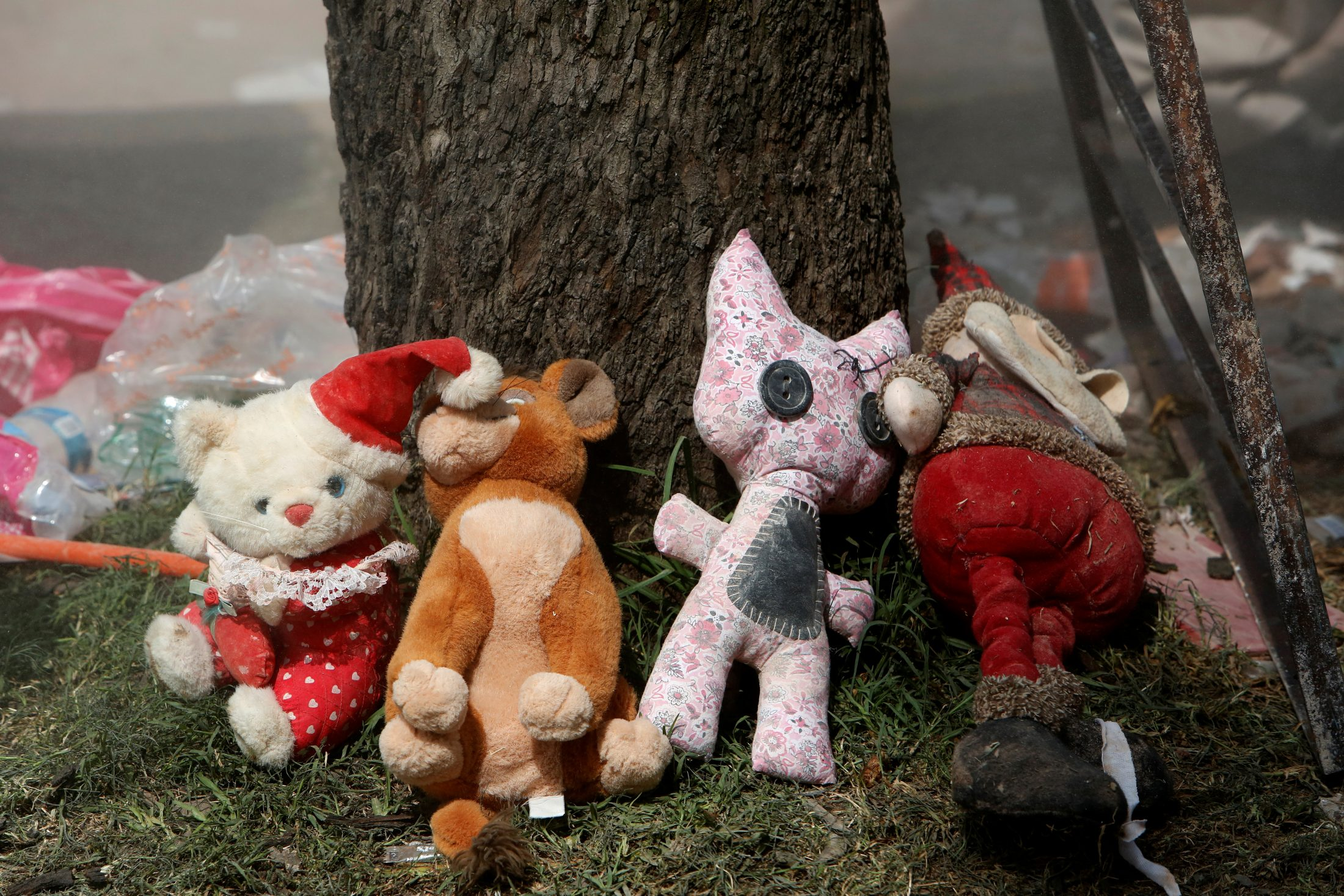 Toys are recovered from the rubble of a collapsed building. Photo by Ginnette Riquelme/Reuters