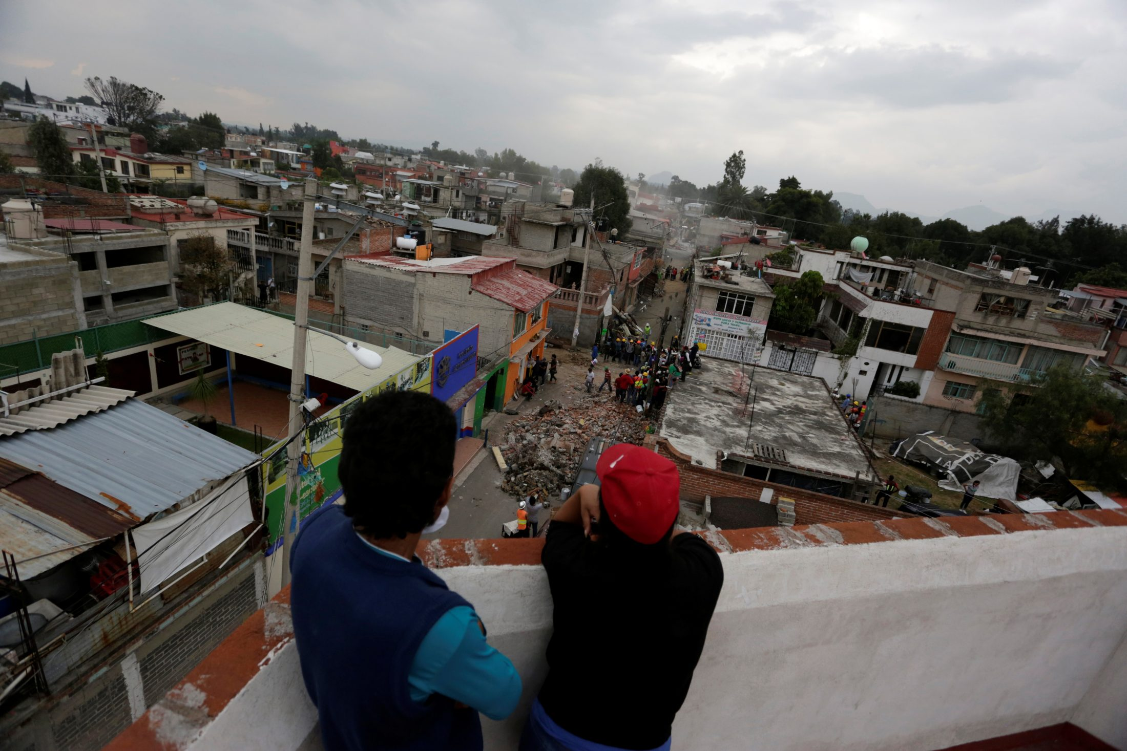 People in Mexico City watch rescuers at work. Photo by Daniel Becerril/Reuters