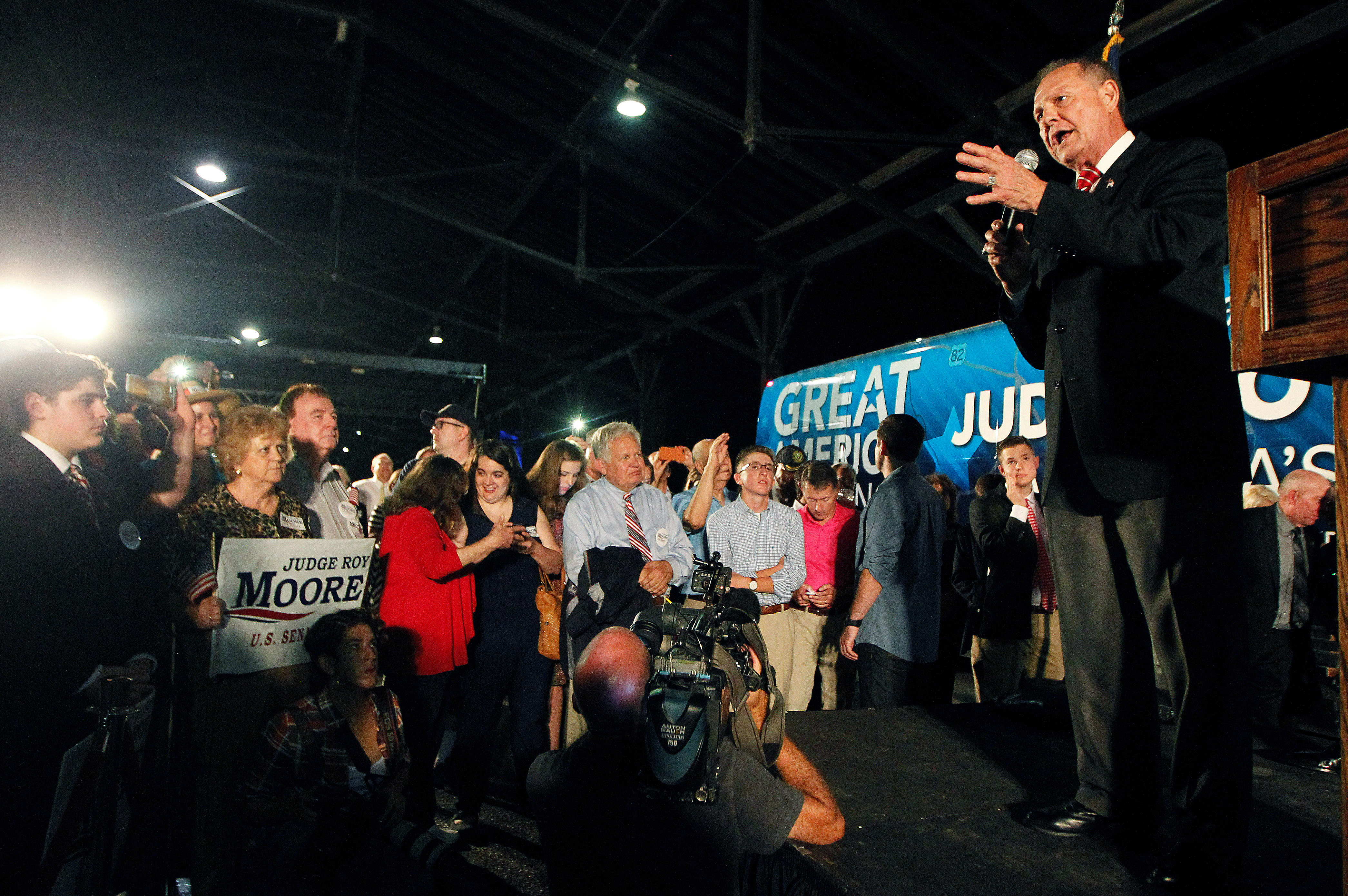 U.S. Senate candidate Judge Roy Moore campaigns at the Historic Union Station Train Shed in Montgomery, Alabama, U.S., September 21, 2017. REUTERS/Tami Chappell - RC190DA22390