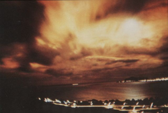 The flash created by Starfish Prime explosion as seen through heavy cloud cover from Honolulu 1,445 km away. Photo via Wikimedia