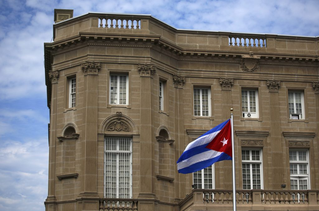 The Cuban national flag is seen over their embassy in Washington, D.C. Photo by Carlos Barria/Reuters