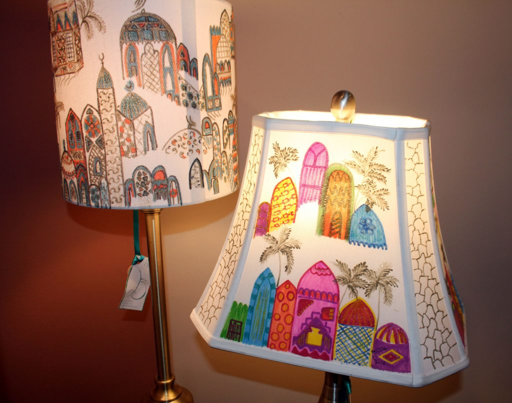 "Uruba ""Ruby"" Rawi decided to paint lampshades with scenes of Iraq to send the message that not everything in her home country is shrouded in darkness. Photo by Larisa Epatko/PBS NewsHour"
