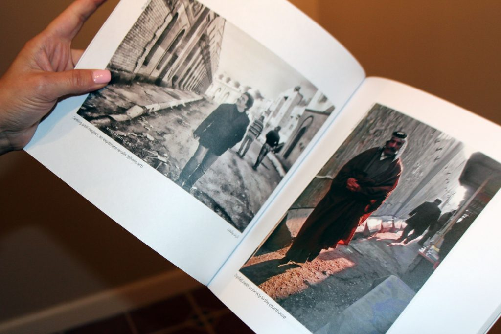 Freelance photographer Mo Shaban returned to his hometown Baghdad in 2012 and photographed the everyday lives of people. His book is for sale in the gallery. Photo by Larisa Epatko/PBS NewsHour