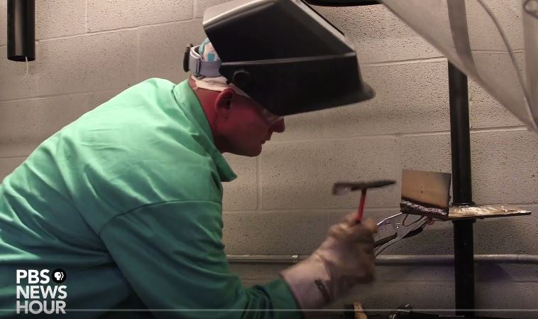 A man in a welding helmet