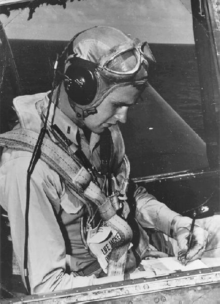 Navy pilot George Bush sits in the cockpit of an Avenger aircraft, c. 1943-45. Photo by George Bush Presidential Library/MCT via Getty Images