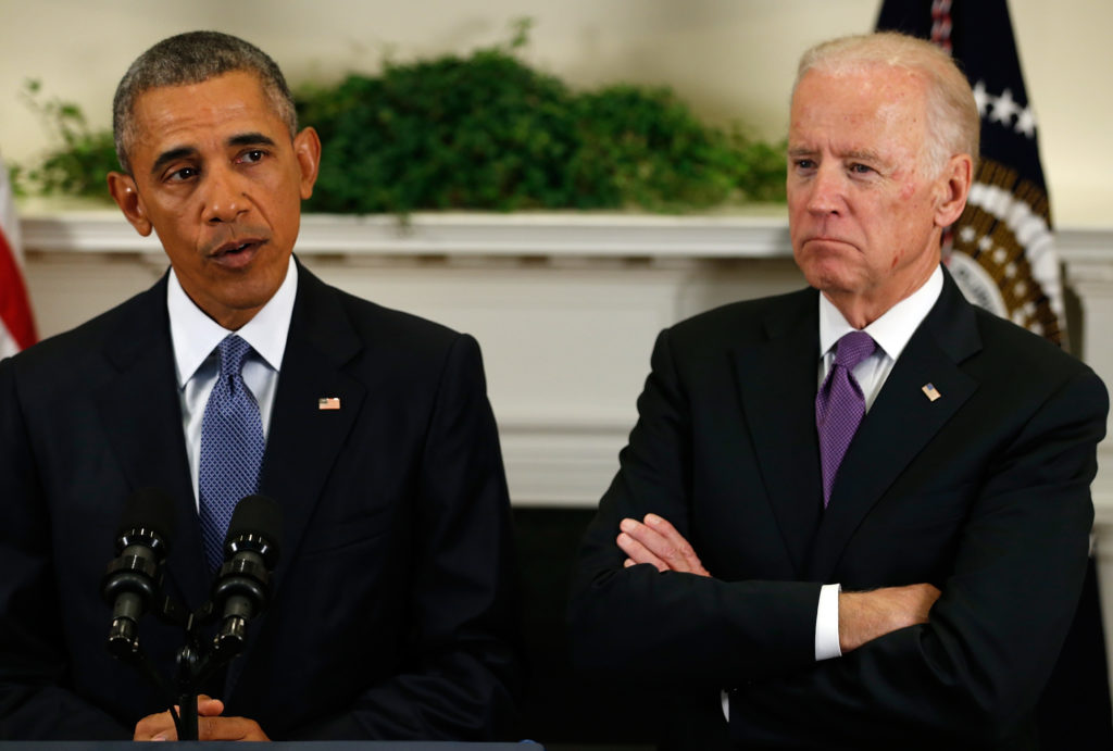 U.S.Vice President Biden stands with President Obama as he announces plans to slow the withdrawal of U.S. troops from Afgh...