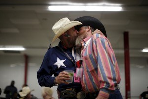 Gordon Satterly, 61, from Michigan (L) kisses his husband Richard Brand, 53, from Texas, at the International Gay Rodeo Association's Rodeo In the Rock party in Little Rock, Arkansas, April 24, 2015. Photo by Lucy Nicholson/Reuters