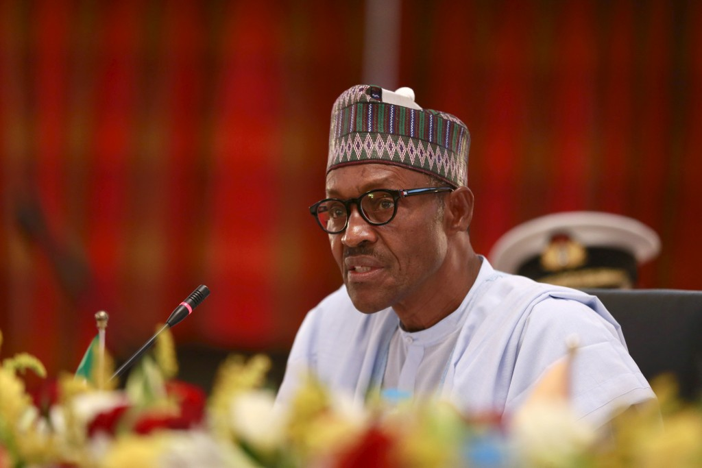 peaks during the opening ceremony for the Summit of Heads of State and Governments of the Lake Chad Basin Commission (LCBC) at the presidential wing of the Nnamdi Azikiwe International Airport Abuja, Nigeria June 11, 2015. New Nigerian President Muhammadu Buhari met his regional counterparts in Abuja on Thursday to set up a joint military force against Boko Haram, the latest sign of his intent to crush the Islamist militant group early in his tenure. The 72-year-old former military ruler, who was inaugurated just two weeks ago, welcomed the leaders of neighboring Chad, Niger and Benin for the impromptu one-day summit at Abuja airport. Cameroon sent its defense minister. REUTERS/Afolabi Sotunde - RTX1G2HT