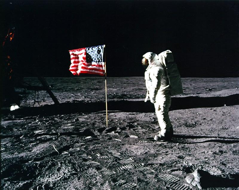 Apollo 11 crew member Buzz Aldrin salutes the U.S. flag. Image courtesy of NASA History Office and the NASA JSC Media Services Center
