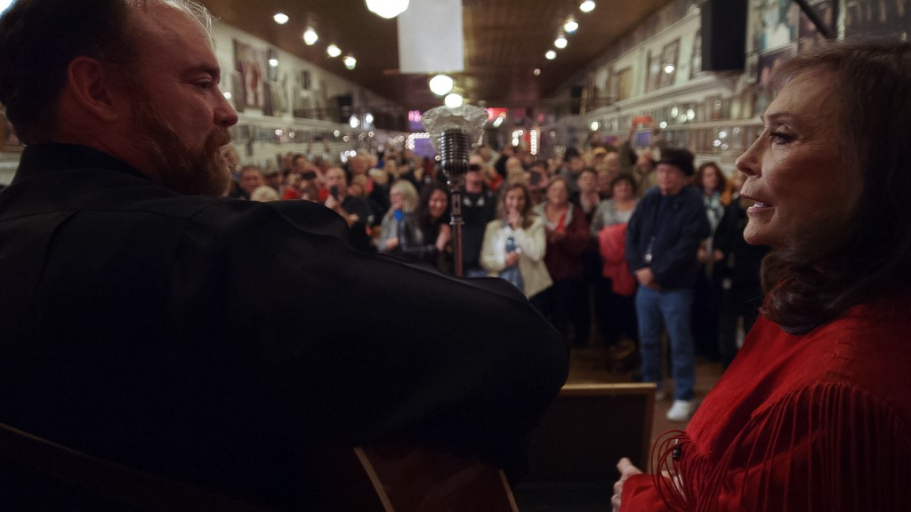 "Loretta Lynn and John Carter Cash perform at the Ernest Tubb Record Shop in Nashville, Tennessee in ""American Masters: Loretta Lynn: Still a Mountain Girl."" Image provided by Yap Films Inc."